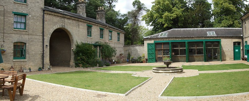 The courtyard after improvements, looking towards the restaurant located in the former coach house.