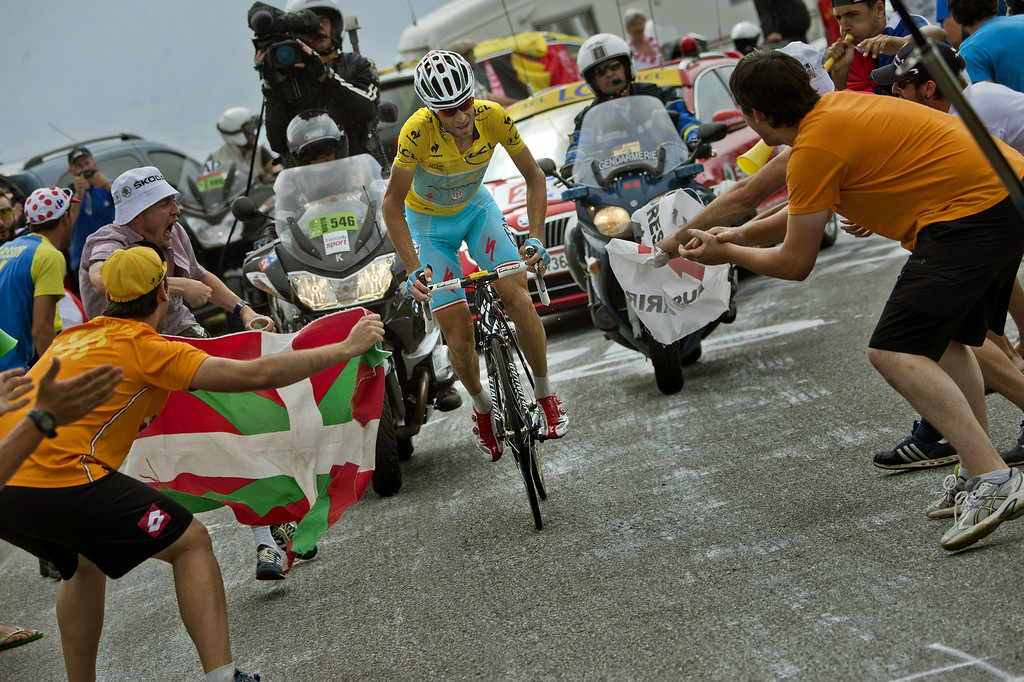 . Italy\'s Vincenzo Nibali wearing the overall leader\'s yellow jersey rides in a breakaway as supporters cheer during the 145.5 km eighteenth stage of the 101st edition of the Tour de France cycling race on July 24, 2014 between Pau and Hautacam, southwestern France.  AFP PHOTO / JEFF PACHOUD/AFP/Getty Images