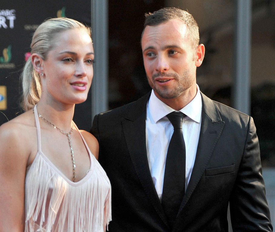 . This picture taken on November 4, 2012 during the Feather Awards held at Melrose Arch in Johannesburg shows South Africa\'s Olympic sprint star Oscar Pistorius and his model girlfriend Reeva Steenkamp. Pistorius has been charged with the Valentine\'s Day murder of Steenkamp, police confirmed on February 14, 2013 ahead of his expected court appearance. South African police played down reports that Pistorius shot dead his girlfriend thinking she was an intruder, saying they had dealt with domestic incidents at his residence and will oppose bail.  LUCKY NXUMALO/AFP/Getty Images