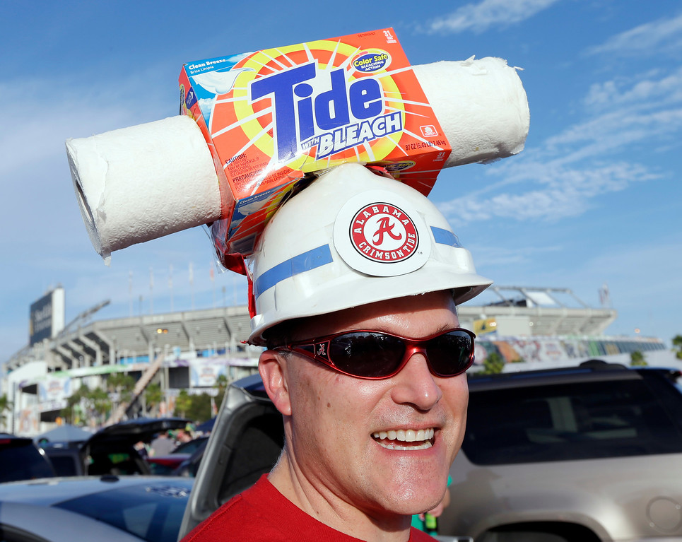 . Brian Dawes of Decatur, Ala., makes his way to Sun Life Stadium before the BCS National Championship college football game between the Alabama and the Notre Dame Monday, Jan. 7, 2013, in Miami. (AP Photo/Chris O\'Meara)