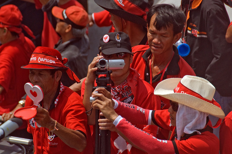 Protester filming the activity of Red Shirt Protest in Thailand