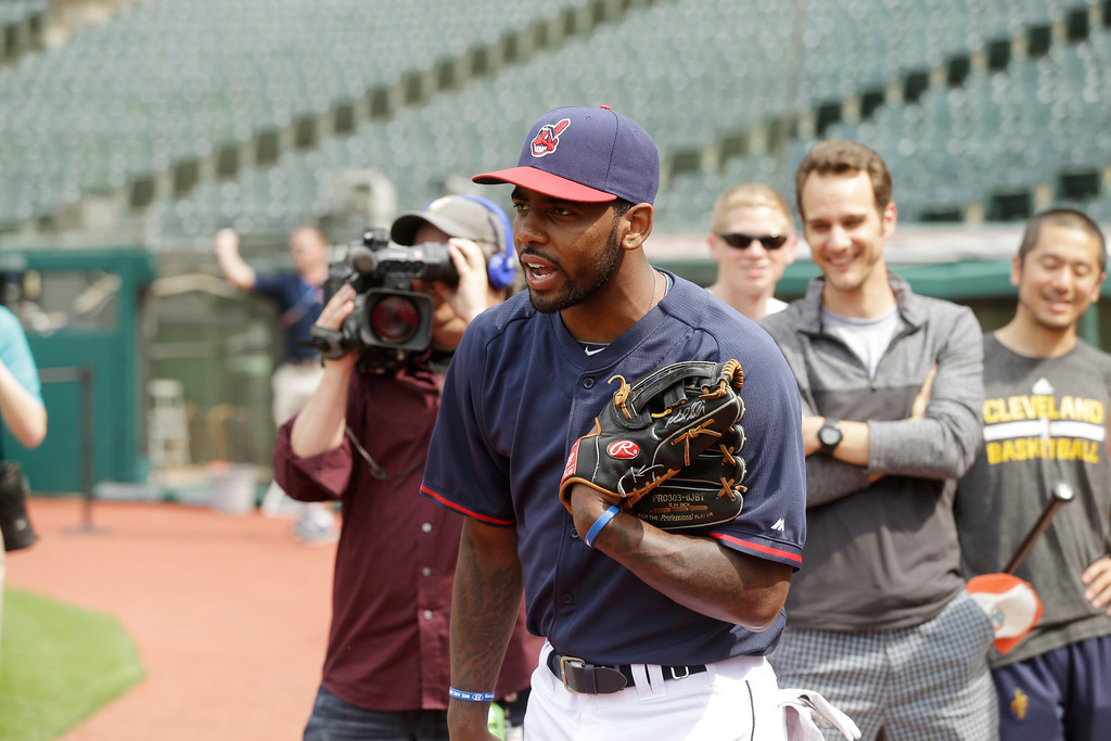. Cleveland Cavaliers\' Kyrie Irving heads to the field for batting practice before a baseball game between the Los Angeles Angels and Cleveland Indians Monday, June 16, 2014, in Cleveland. (AP Photo/Mark Duncan)