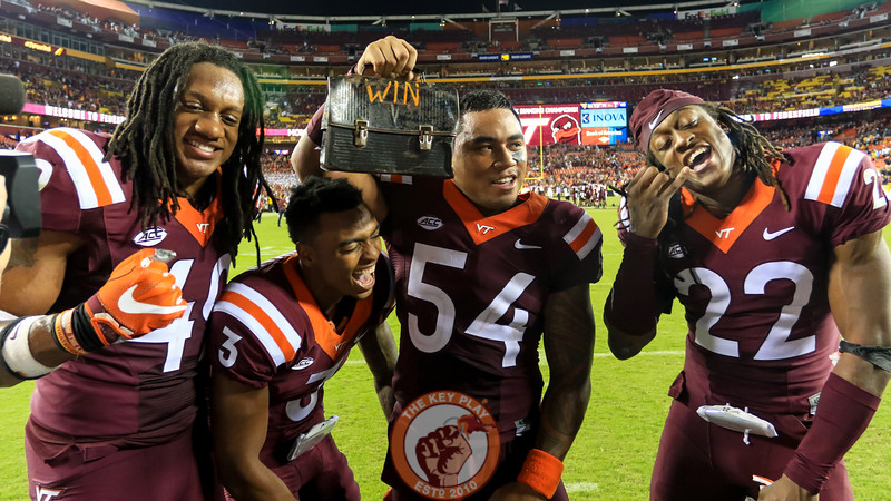 (L-R) Tremaine Edmunds, Greg Stroman, Andrew Motuapuaka, and Terrell Edmunds celebrate with the lunchpail after the end of the game. (Mark Umansky/TheKeyPlay.com)