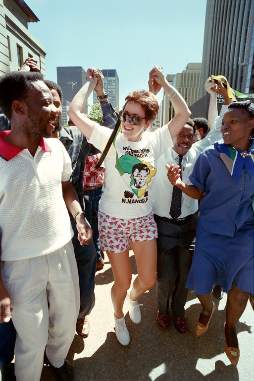 . People dance in central Johannesburg street on February 23, 1990 as hundreds of Democratic Party supporters marched for Democracy to city hall to hear speeches by party leaders who had met earlier with African National Congress leader Nelson Mandela. (Photo credit should read ALEXANDER JOE/AFP/Getty Images)