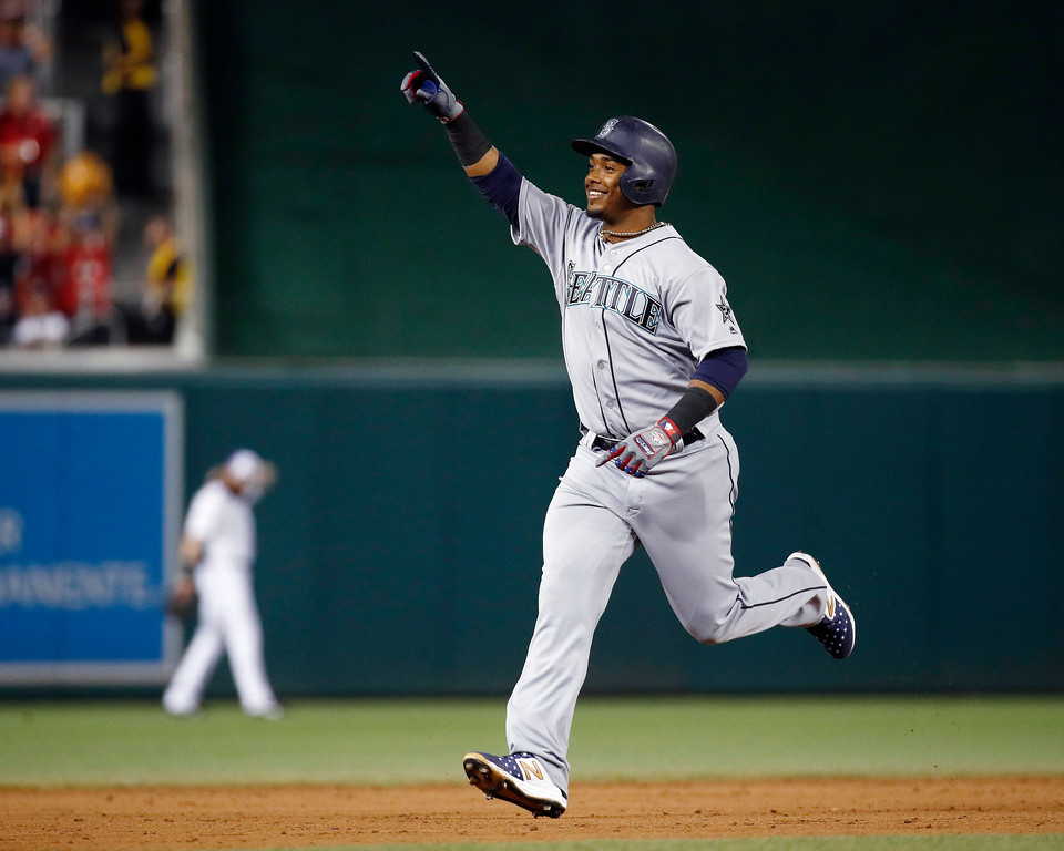 . Seattle Mariners Jean Segura (2) celebrates his three-run homer in the eight inning during the Major League Baseball All-star Game, Tuesday, July 17, 2018 in Washington. (AP Photo/Patrick Semansky)