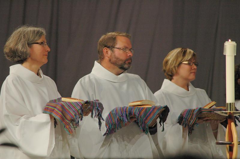 Communion assistants prepare for Thursday's Eucharist.