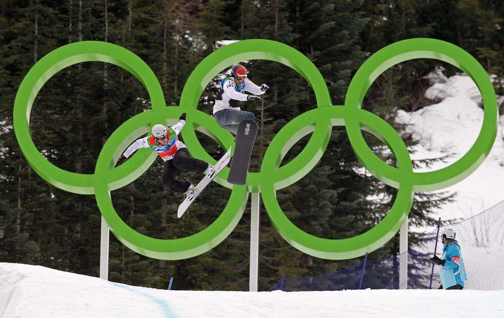 . Gold medalist Seth Wescott, right, of the U.S., passes silver medallist Mike Robertson, of Canada, near the end of the course during the men\'s snowboard cross final at the 2010 Vancouver Olympic Winter Games at Cypress Mountain in Vancouver, British Columbia, Monday February 15, 2010. (AP Photo/The Canadian Press, Darryl Dyck)