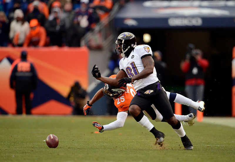. Denver Broncos cornerback Chris Harris (25) breaks up a pass intended for Baltimore Ravens wide receiver Anquan Boldin (81) during the first half.  The Denver Broncos vs Baltimore Ravens AFC Divisional playoff game at Sports Authority Field Saturday January 12, 2013. (Photo by John Leyba,/The Denver Post)