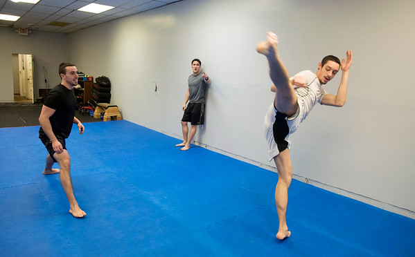 01/07/20 Wesley Bunnell | StaffrrWarming up at New Britain Judo & Dynamic Arts on West Main St in New Britain are Kyle Messina, L, Peter Giannola and Michael Colon.