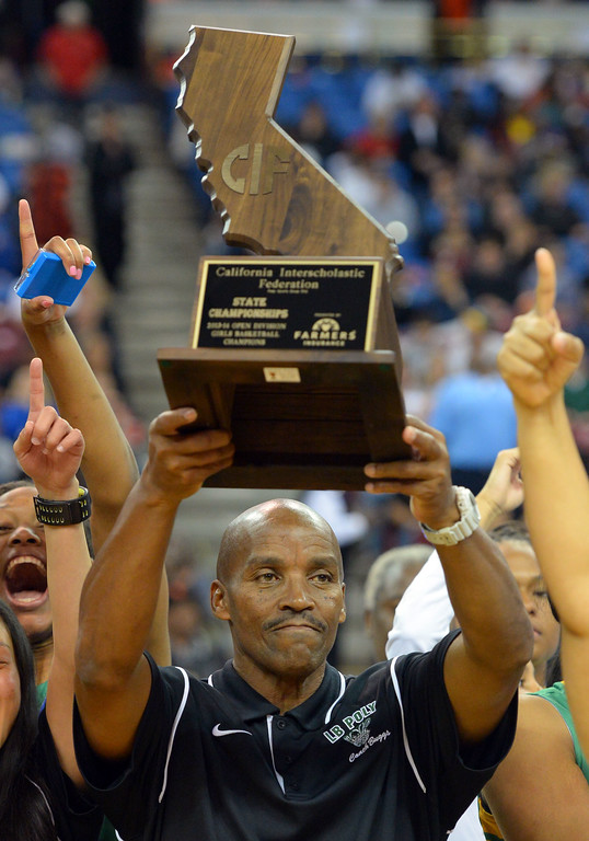. Poly coach Carl Buggs with the state trophy at Sleep Train Arena in Sacramento, CA on Saturday, March 29, 2014. Long Beach Poly vs Salesian in the CIF Open Div girls basketball state final. 2nd half. Poly won 70-52. (Photo by Scott Varley, Daily Breeze)