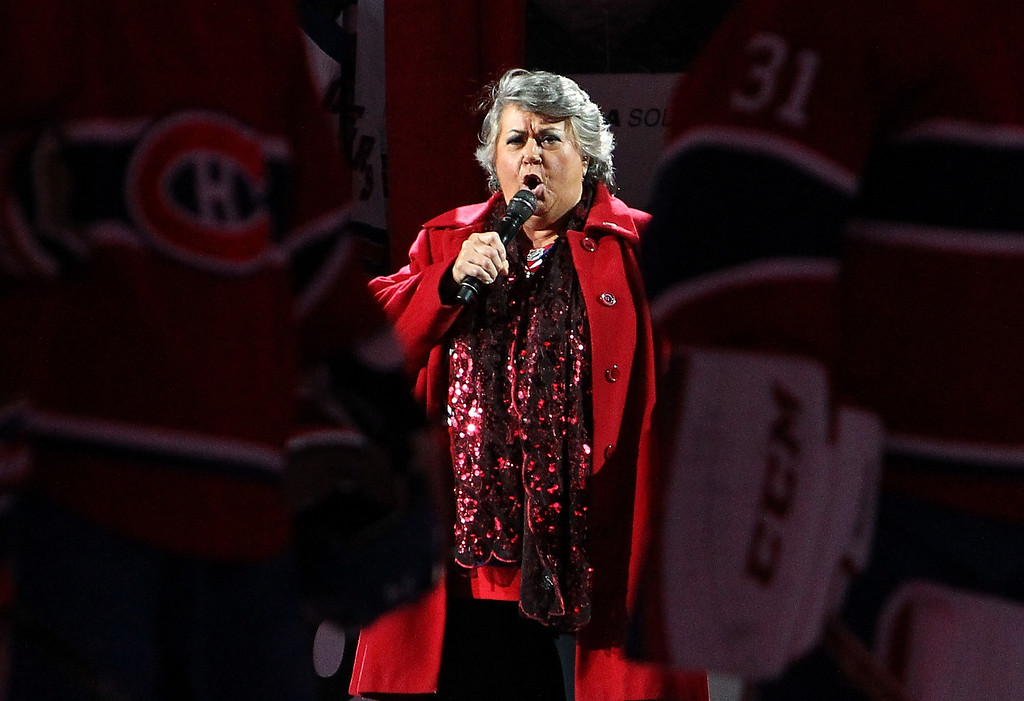 . MONTREAL, QC - MAY 17:  Author/composer/singer Ginette Reno performs the national anthem before Game One of the Eastern Conference Finals of the 2014 NHL Stanley Cup Playoffs between the Montreal Canadiens and the New York Rangers at the Bell Centre on May 17, 2014 in Montreal, Canada.  (Photo by Francois Laplante/Freestyle Photography/Getty Images)