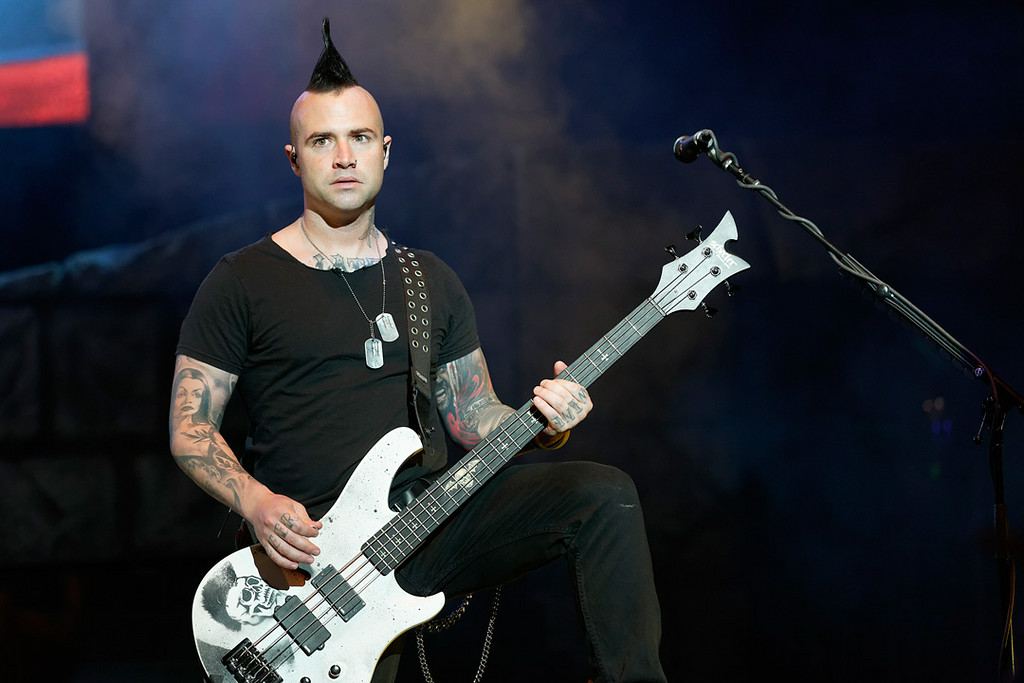 . Avenged Sevenfold\'s Johnny Christ performs at Mayhem Festival on Thursday, July 18, 2014, at DTE Energy Theatre, Independence Township. Photo by Ken Settle