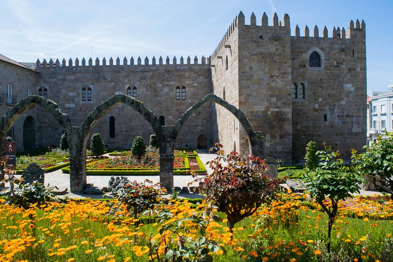 Arches from a burned portion of Episcopal Palace decorate the colorful gardens of Santa Barbara in Braga.