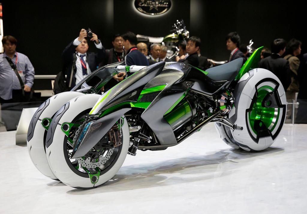 . Kawasaki Motors introduces the electric tricycle J at the 43rd Tokyo Motor Show 2013 in Tokyo, Japan, 20 November 2013.   EPA/KIMIMASA MAYAMA