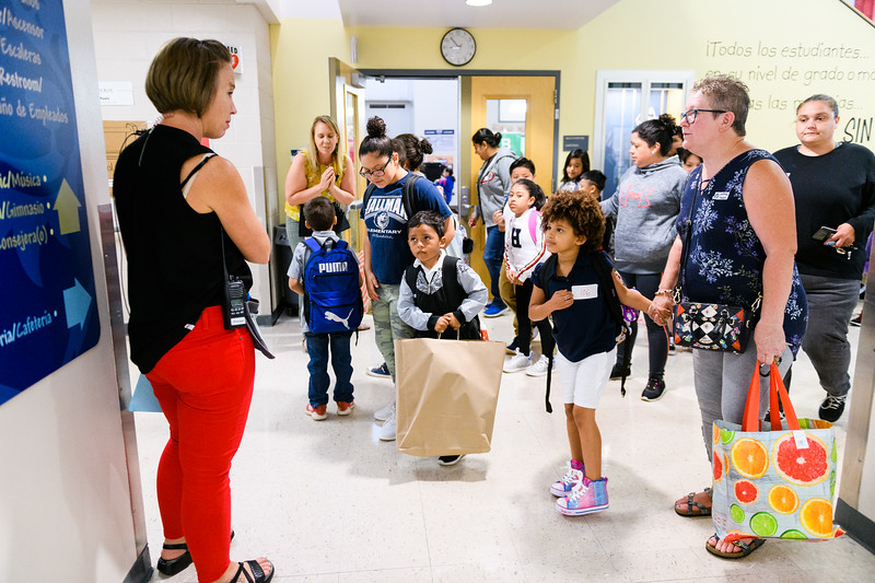 Hallman principal Jessica Brenden, far left, greets students and their families. Back to school day at Hallman Elementary School on Wednesday, September 4, 2019 in Salem, Ore.