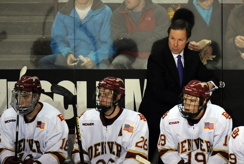 . University of Denver head coach George Gwozdecky is in the bench during the game against Boston University at Magness Arena in Denver, Colo. on Saturday, December 29, 2012. Hyoung Chang, The Denver Post