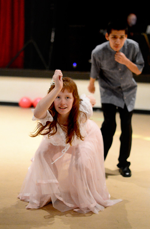 . Erin Michaels, 18, and Richard Perez, 15, of Azusa High School, do the twist during Glendora High School\'s Best Buddies Prom for high school students with special needs Friday night, April 19, 2013 at the Glendora campus. (SGVN/Staff Photo by Sarah Reingewirtz)