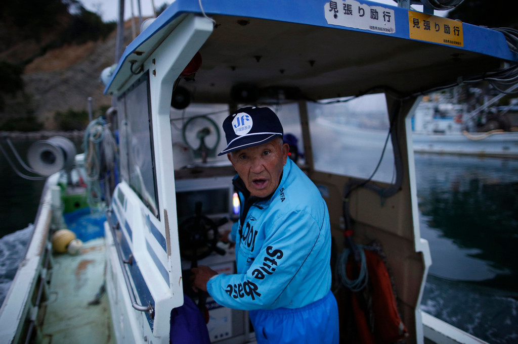 ". 80-year-old fisherman Shohei Yaoita stands aboard his boat ""Shoei Maru\"", about 30 km (19 miles) south of Fukushima Daiichi nuclear power plant, Fukushima prefecture May 26, 2013. Yaoita\'s catch will be used to test for radioactive contamination in the waters near the nuclear facility. Commercial fishing has been banned near the tsunami-crippled nuclear complex since the March 2011 tsunami and earthquake. The only fishing that still takes place is for contamination research, and is carried out by small-scale fishermen contracted by the government. Picture taken May 26, 2013. REUTERS/Issei Kato"