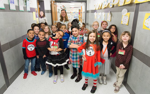 03/01/19 Wesley Bunnell | Staff Deion Chan, far L, Lilyana Correa, 3rd L, Camila Arango, 4th L, Arianna Garcia, 5th L, and classmates pose for a photo in a hallway at Gaffney Elementary School on Friday March 1st along with first grade teacher Shannon Coviello for Read Across America Day which is held on Dr. Seuss's birthday on March 2nd of every year.