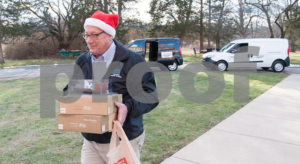 12/20/17 Wesley Bunnell | Staff Papas Dodge delivered donations to the Prudence Crandall Center on Wednesday afternoon as part of its fill the van drive held over the last several weeks. Household items were collected at the dealership such as bedding, clothes, small appliances and other household necessities clients of the center who are victims of domestic violence. Service and Parts Director Phil Vetre carries the last of the donated items.
