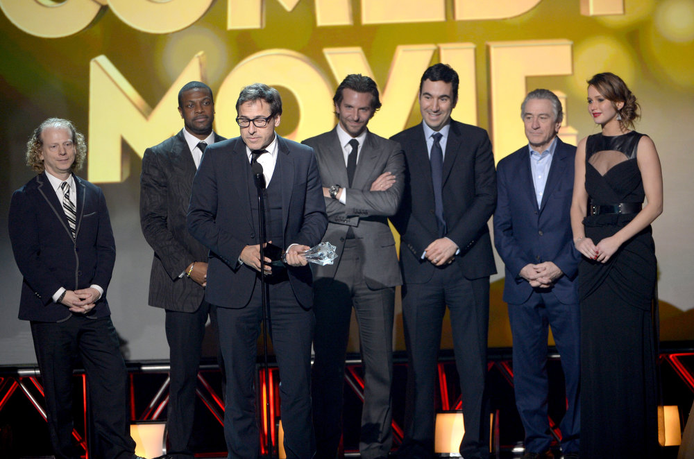Description of . Director David O. Russell (2nd L) with cast and crew onstage at the 18th Annual Critics' Choice Movie Awards held at Barker Hangar on January 10, 2013 in Santa Monica, California.  (Photo by Kevin Winter/Getty Images)