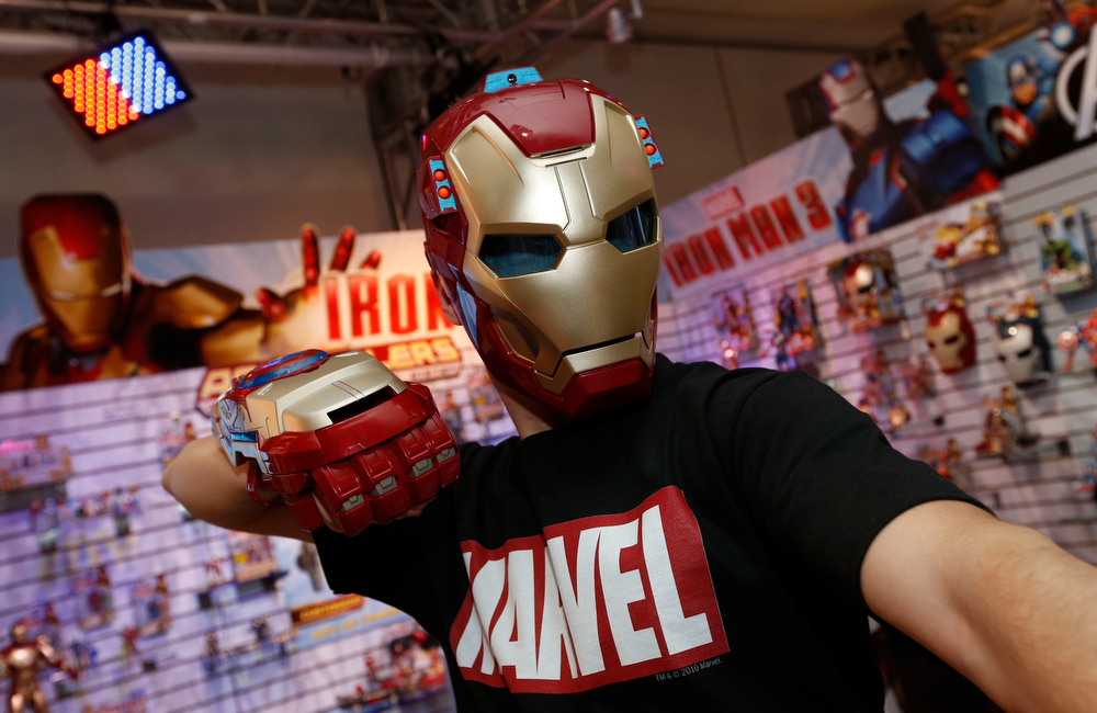 . Toy demonstrator Clayton Morris dons the IRON MAN 3 ARC FX MISSION MASK and IRON MAN 3 MOTORIZED ARC FX GAUNTLET, part of Hasbroís IRON MAN 3 line of toys, in the companyís showroom at the American International Toy Fair, Friday, Feb. 8, 2013, in New York. (Photo by Jason DeCrow/Invision for Hasbro/AP Images)