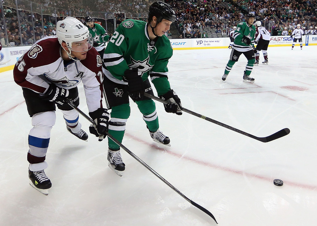 . Paul Stastny #26 of the Colorado Avalanche and Cody Eakin #20 of the Dallas Stars skate the puck in the second period at American Airlines Center on December 17, 2013 in Dallas, Texas.  (Photo by Ronald Martinez/Getty Images)