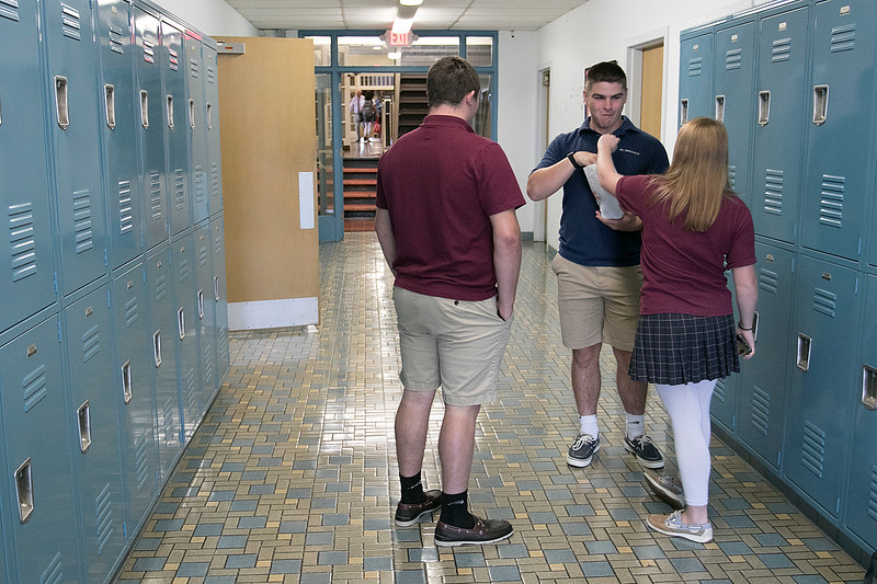On this day Thursday, August 29, 2019 100 years ago Saint Bernard's Central Catholic High School in Fitchburg opened it's doors. Students hang out in the hall just before the new  common homeroom started in the Media Center at the school. This new idea for everyone to gather at the beginning of the day is new this year and is suppose to help everyone to come together as one and bond as a school. SENTINEL & ENTERPRISE/JOHN LOVE