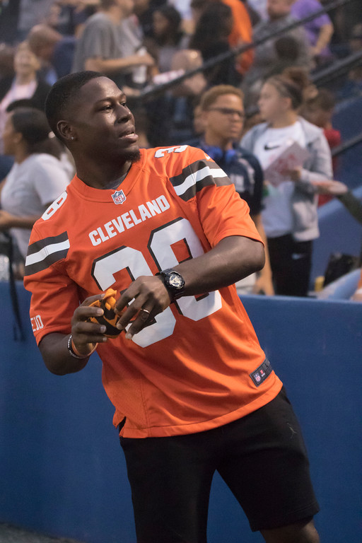 . Jen Forbus - The Morning Journal<br> Cleveland Browns defensive back T.J. Carrie launches a towel into the bleachers during Lorain\'s game against St. Joseph on Sept. 14.