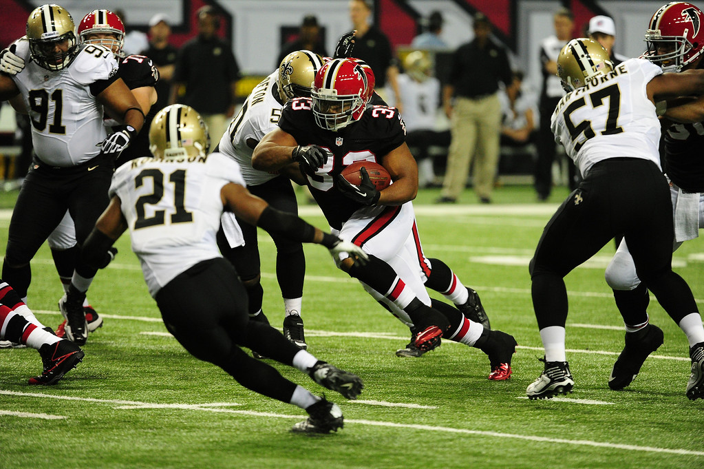 . ATLANTA, GA - NOVEMBER 18:  Michael Turner #33 of the Atlanta Falcons carries the ball against the New Orleans Saints at the Georgia Dome on November 29, 2012 in Atlanta, Georgia  (Photo by Scott Cunningham/Getty Images)