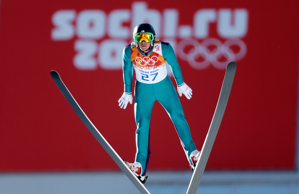 . United States\' Bill Demong makes his trial jump during the ski jumping portion of the Nordic combined at the 2014 Winter Olympics, Wednesday, Feb. 12, 2014, in Krasnaya Polyana, Russia. (AP Photo/Matthias Schrader)