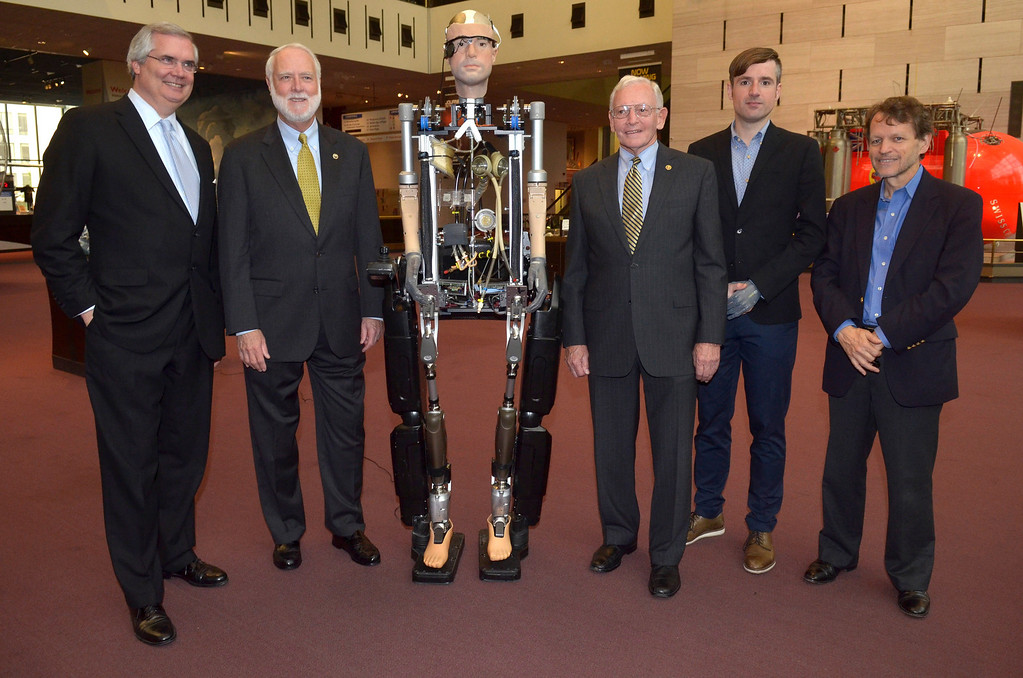 . Chris Liedel, Wayne Clough, Berlolt Meyer and Jack Daily pose for a photo during The Incredible Bionic Man arrival at the Smithsonian National Air and Space Museum where he will be on display through the fall, the subject of the new Smithsonian Channel special premiering Sunday, October 20 at 9pm on October 17, 2013 in Washington, DC. (Photo by Kris Connor/Getty Images for Showtime)