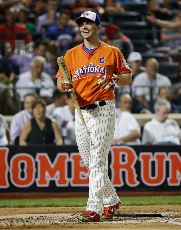 . National League captain David Wright, of the New York Mets, walks off the field after his at bat during the MLB All-Star baseball Home Run Derby, on Monday, July 15, 2013 in New York. (AP Photo/Matt Slocum)