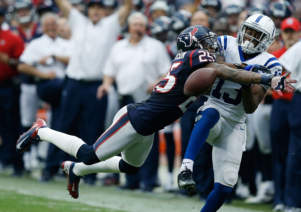 . Kareem Jackson #25 of the Houston Texans breaks up a pass intended for T.Y. Hilton #13 of the Indianapolis Colts at Reliant Stadium on December 16, 2012 in Houston, Texas.  (Photo by Scott Halleran/Getty Images)