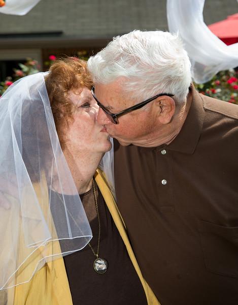 Mam and Badge kissing at the altar.jpg