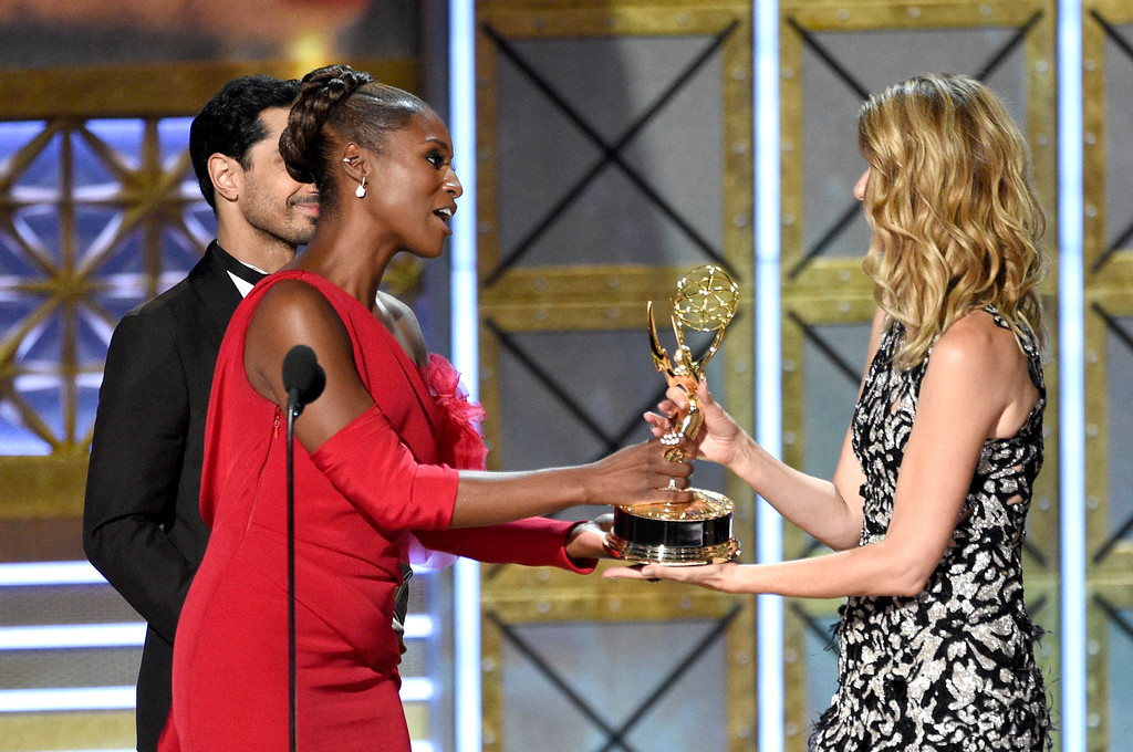 ". Riz Ahmed, left, and Issa Rae present the award for outstanding supporting actress in a limited series or movie to Laura Dern, for ""Big Little Lies\"" at the 69th Primetime Emmy Awards on Sunday, Sept. 17, 2017, at the Microsoft Theater in Los Angeles. (Photo by Chris Pizzello/Invision/AP)"