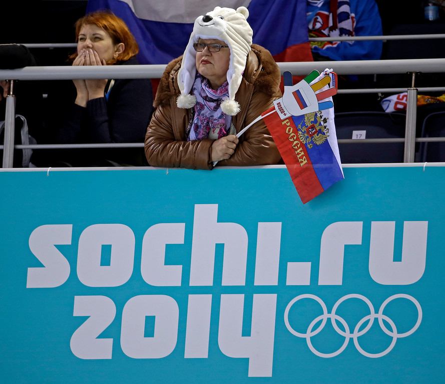 . Russian fans watch a round robin match between Russia and Britain the 2014 Winter Olympics, Monday, Feb. 17, 2014, in Sochi, Russia. Britain won 9-6. (AP Photo/Morry Gash)