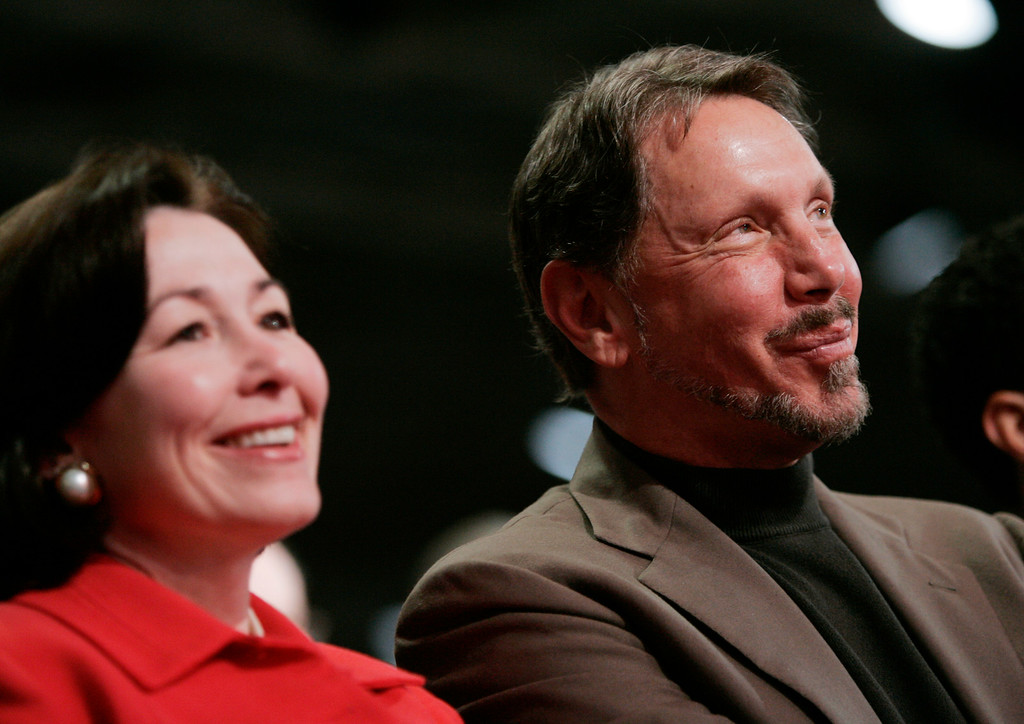 . Oracle Corp. CEO Larry Ellison, right, and President and CFO Safra Catz, smile during Oracle Open World conference in San Francisco, Wednesday, Nov. 14, 2007.  (AP Photo/Paul Sakuma)