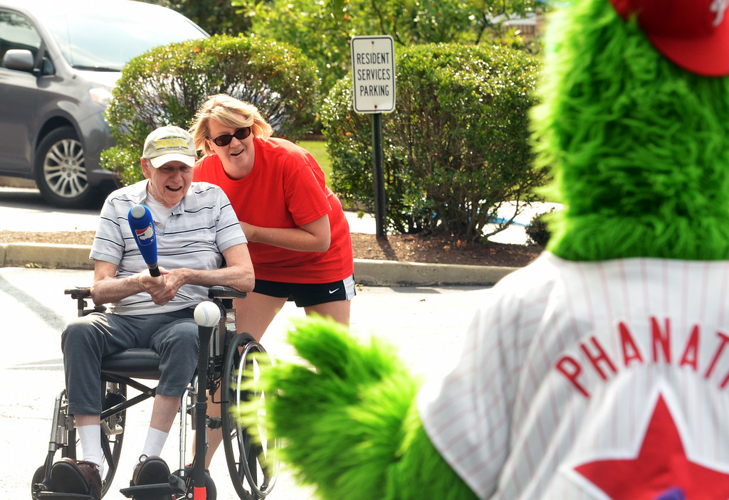 . A resident takes a swing during a baseball game at the Dock Terrace Fifth Annual Senior Olympics in Towamencin.   The Philly Phanatic made a guest appearance, delivered high-fives,  posed for pictures and videos, and joined the game.    Youngsters from nearby Salford Mennonite Childcare Center finished the game begun by the seniors.    Thursday,  August 21, 2014.    Photo by Geoff Patton