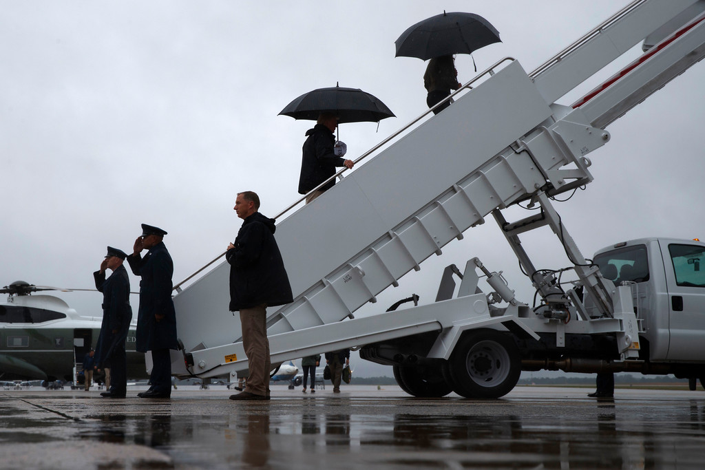 . President Donald Trump and first lady Melania Trump board Air Force One at Andrews Air Force Base, Md., Tuesday, Aug. 29, 2017, for a trip to Texas to get an update on Harvey relief efforts. (AP Photo/Evan Vucci)
