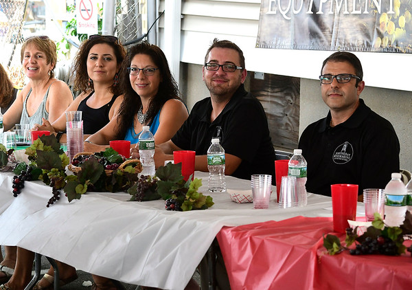 7/28/2018 Mike Orazzi | Staff The annual wine contest during the 14th annual Italian Festival held of Lower Center Street in Southington Saturday.