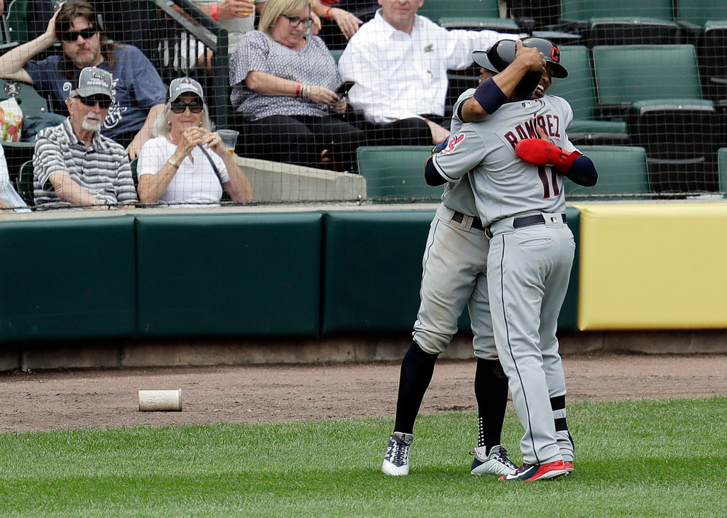 . Cleveland Indians\' Jose Ramirez (11) is hugged by Francisco Lindor after the pair scored after Ramirez\'s two-run home run off Chicago White Sox relief pitcher Chris Volstad in the seventh inning of baseball game Thursday, June 14, 2018, in Chicago. (AP Photo/Annie Rice)