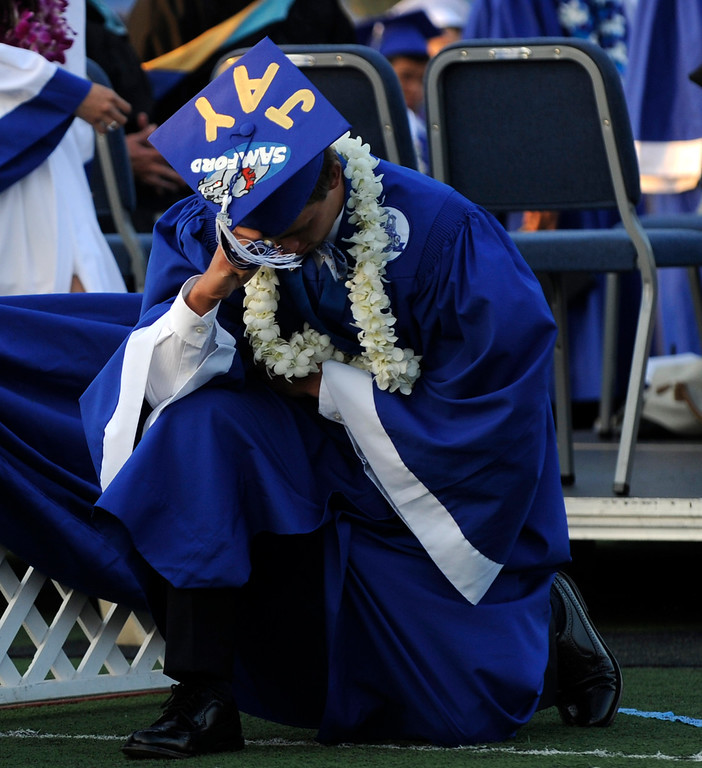 . A graduate celebrates after receiving his diploma during the San Marino High School commencement at San Marino High School on Friday, June 7, 2013 in San Marino, Calif.  (Libby Cline for the Pasadena Star-News)