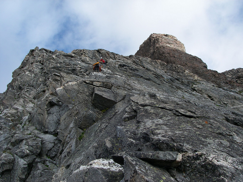 """Drizzlepuss, a tower with what the guidebook describes as a """"terrifying view"""" of the route. In front of us are two EXUM guides with two of their clients (father and daughter)."""