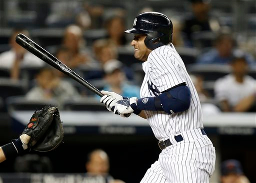 . New York Yankees\' Derek Jeter reacts as he is hit by a pitch from Detroit Tigers relief pitcher Joba Chamberlain in the 10th inning of a baseball game at Yankee Stadium in New York, Tuesday, Aug. 5, 2014.  (AP Photo/Kathy Willens)