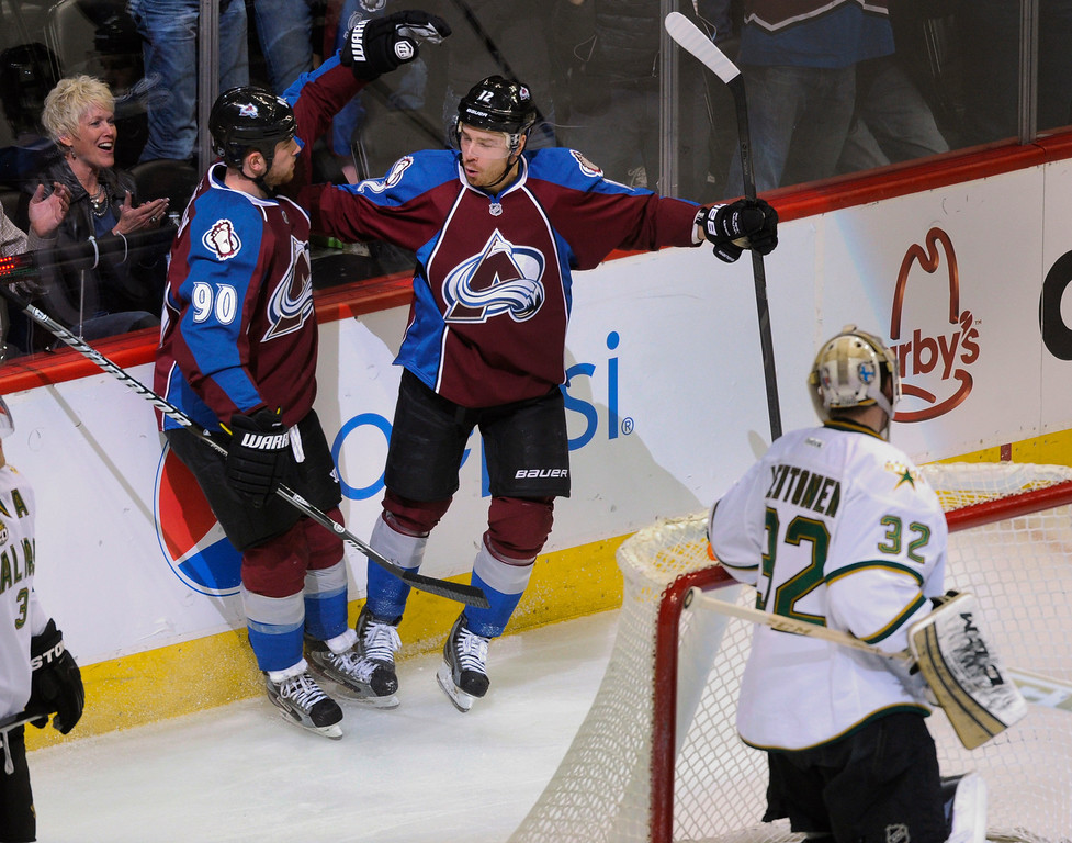 . DENVER, CO. - MARCH 12: Ryan O\'Reilly (90) of the Colorado Avalanche was congratulated by teammate Chuck Kobasew (12) following his equalizer in the third period. The Colorado Avalanche came back to beat the Dallas Stars 4-3 Wednesday night, March 19, 2013 at the Pepsi Center in Denver. (Photo By Karl Gehring/The Denver Post)