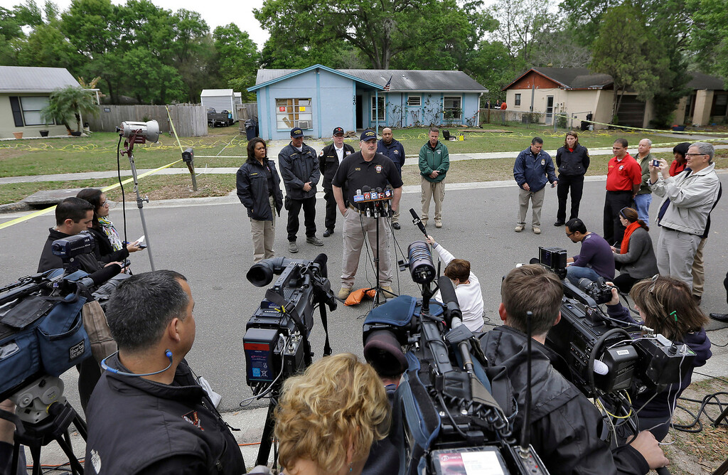 . Hillsborough County, Fla., Fire Chief Ron Rogers speaks to the media in front of a home where sinkhole opened up underneath a bedroom and swallowed a man Friday, March 1, 2013, in Seffner, Fla. (AP Photo/Chris O\'Meara)