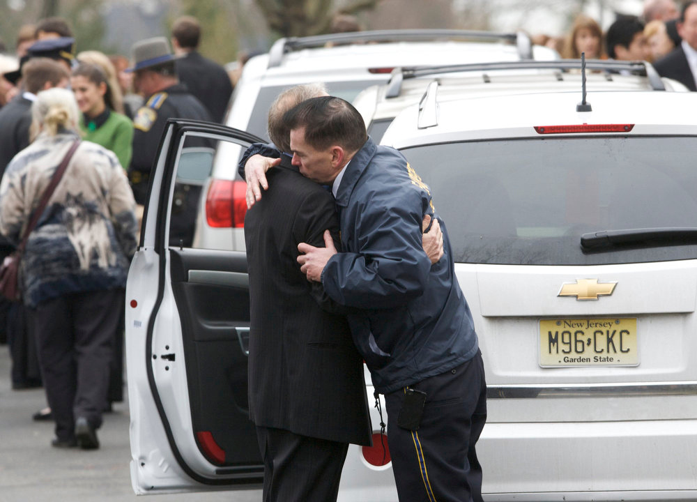. People embrace as they leave the funeral services for Noah Pozner in Fairfield, Connecticut December 17, 2012. Pozner,6, was the youngest victim of Friday\'s shooting at Sandy Hook Elementary School in Newtown, Connecticut. REUTERS/Michelle McLoughlin