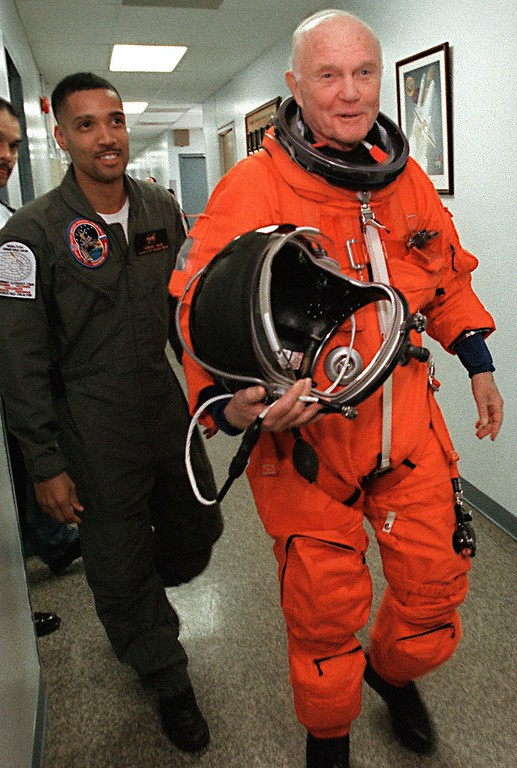 . Sen. John Glenn , D-Ohio, is shown in his space shuttle flight suit as he walks with NASA\'s Carlous Gillis, left, to the centrifuge training area at Brooks Air Force Base Research Labratory in Texas, Thursday, Feb. 19, 1998. The centrifuge is used by NASA Space Shuttle astronauts to simulate the G-forces astronauts experience during a shuttle launch. Glenn\'s training in the centrifuge will help prepare  him for his shuttle mission in October. (AP Photo/Kin Man Hui, Pool)