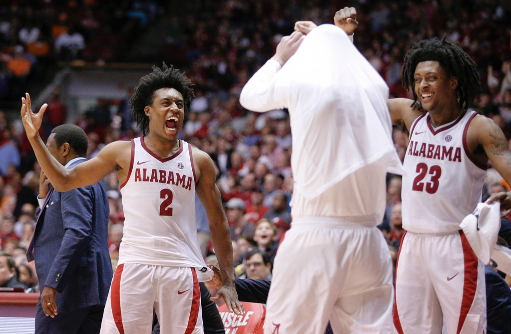 . Alabama guard Collin Sexton celebrates on the sideline during the second half of an NCAA college basketball game on Saturday, Feb. 10, 2018, in Tuscaloosa, Ala. Alabama won 78-50. (AP Photo/Brynn Anderson)